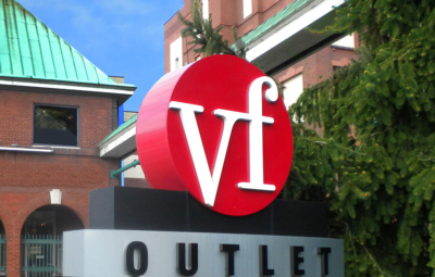 VF Outlet Complex, red and white signage with buildings