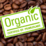 PrimusLabs Organic Certified Logo, lime green, with brown coffee beans in background